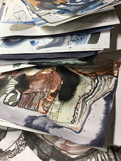 a stack of paintings